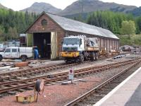 Truck come OnTrack Machine in sidings at Crianlarich.<br><br>[Colin Harkins&nbsp;06/05/2005]