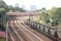 Coal empties westbound through Rutherglen on 15 August 2006 on their way back to Hunterston. (Taken through the cleanest window of the station's pedestrian walkway). <br><br>[John Furnevel&nbsp;15/08/2006]