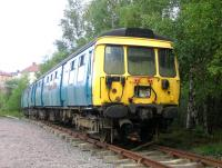 Preserved <I>Blue Train</I> exhibit, former unit 311103, photographed at Summerlee in August 2006. By this time DTS vehicle 977846 had been removed from the formation and scrapped, with the two remaining cars relocated here at the rear of the yard alongside the Whifflet line. [See image 29597] <br><br>[John Furnevel&nbsp;29/08/2006]