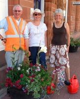 Volunteers at Dumfries station in July standing alongside some of the striking floral displays that now adorn the platforms.<br><br>[ScotRail&nbsp;/07/2013]