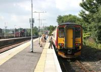 Bay platform 3 at Barrhead in August 2006, with a train boarding for Glasgow Central.<br><br>[John Furnevel&nbsp;17/08/2006]