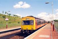 Westbound DMU pauses at Carmyle. Shortly before withdrawl of the 101s.<br><br>[Ewan Crawford&nbsp;//1998]