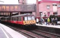 Motherwell Platform 2, a Lanark - Dalmuir service stops to pick up a large number of passengers.<br><br>[Brian Forbes&nbsp;/03/2002]