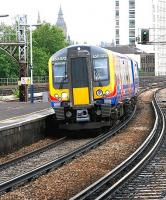 Train from Waterloo passing through Vauxhall in July 2005 en route to Portsmouth Harbour.<br><br>[John Furnevel&nbsp;/07/2005]