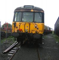 A Milngavie train - at Boness! A hybrid 303 with 303032 (A end) standing in the yard on 6 September 2006 at a rain soaked SRPS, Boness. [See image 48497]<br><br>[John Furnevel&nbsp;06/09/2006]