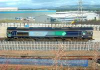 DRS Class 66 66403 at WH Malcolms Elderslie Freight Terminal offloading freight. The freight trains are now using the new concreted part of the terminal.<br><br>[Graham Morgan&nbsp;06/09/2006]