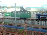DRS Class 66 66403 at WH Malcolms Elderslie Freight Terminal offloading freight. Here a mobile crane lifts an ISO box from a flat car for transfer to an articulated lorry.<br><br>[Graham Morgan&nbsp;06/09/2006]
