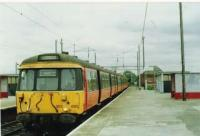 A refurbished 303 stops on a service to Balloch.<br><br>[Brian Forbes&nbsp;/10/1994]