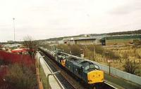 37012/044 reach the top of Cumbernauld bank  with a train of empty tanks for Bowling Harbour.<br><br>[Brian Forbes&nbsp;/01/1983]
