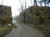 The deck of the railway bridge at Eshiels over the road leading to water treatment works has been removed although the abutments still stand in March 2006.<br><br>[Colin Harkins&nbsp;/03/2006]