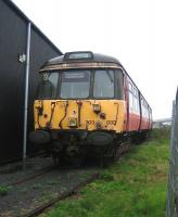 303032 (B end) standing in the rain at Boness on 6 September 2006.<br><br>[John Furnevel&nbsp;06/09/2006]