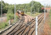 A Whifflet - Glasgow Central train at Whifflet North Junction in August 2006. The line to Coatbridge Central is on the right and the bridge that carried the Caledonian High Level line is in the right background.<br><br>[John Furnevel&nbsp;24/08/2006]