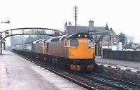 The 1140 Inverness - Aberdeen calls at Nairn, powered by 2 dirty 27s.<br><br>[Brian Forbes&nbsp;//]
