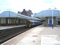 Platform view at Arbroath looking south in August 2006. The through platform on the right is disused as is the old goods yard and shed beyond. <br><br>[John Furnevel&nbsp;09/08/2006]