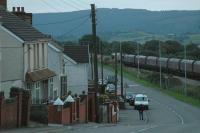 Coal in the valleys; as it grows dark a loaded coal train runs downhill through Tynewdd from Onllwyn.<br><br>[Ewan Crawford&nbsp;13/09/2006]