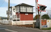 Looking west over the level crossing at Errol on 4 September 2006. A right turn after the signal box leads into the old yard and the former station itself. The old station building is currently operating as a craft shop and tea room. <br><br>[John Furnevel&nbsp;04/09/2006]
