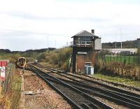 The train emerging from the siding is for Queen Street. It will go through the crossover, stop at the Cumbernauld platform then leave at 1444. Note the CR style of railed balcony on the Signal box.<br><br>[Brian Forbes&nbsp;//1993]