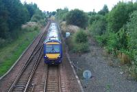 An eastbound train passes the former Bishopbriggs oil terminal (right) and is about to enter Cadder Yard.<br><br>[Ewan Crawford&nbsp;22/09/2006]