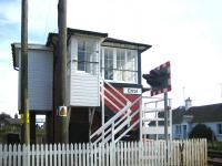 The signal box on the down side approaching Errol station, looking east from the level crossing in November 2006. The surviving station building and dodgy footbridge are visible in the left background.<br><br>[John Furnevel&nbsp;15/11/2006]