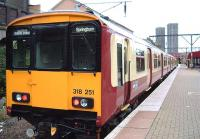Newly painted classs 318 at Bellgrove heading for Springburn<br><br>[Colin Harkins&nbsp;22/10/2005]