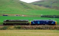 Strange working: 47815/D1748 Great Western and 37515 head south loudly. Almost blottng out the noise of the M74.<br><br>[Ewan Crawford&nbsp;29/09/2006]