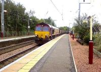 66099 passing through Johnstone Station with a loaded coal train heading for Longannet PS<br><br>[Graham Morgan&nbsp;30/09/2006]