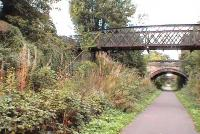 Eskbank & Dalkeith, now overgrown. Steps up to old footbridge from platform visible. This station closed with the entire Waverley line in 01.1969<br><br>[Brian Forbes&nbsp;02/10/2006]