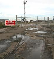 The closed off entrance to Leith docks from the north end of Constitution Street in September 2006. For the view in the other direction [see image 11375].<br><br>[John Furnevel&nbsp;12/09/2006]