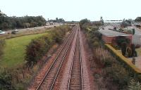 Road v Rail. The A90 Perth to Dundee dual carriageway accompanies the D & PR. The old Glencarse station is at the top of the frame. Photographed from St Madoes Road bridge.<br><br>[Brian Forbes&nbsp;/08/2006]