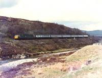 47517 on its way south from Dalwhinnie to Drumochter Summit, with the 1230 Inverness to Edinburgh.<br><br>[Brian Forbes&nbsp;/04/1983]
