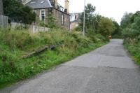 Looking along the trackbed and platform remains at Merchiston station on 5 October 2006. View is east towards the former Princes Street station. This section of the old route now serves as the eastern access to Slateford Yard (behind the camera). The road entry from Harrison Gardens is to the right where the JCB is parked.  <br><br>[John Furnevel&nbsp;05/10/2006]