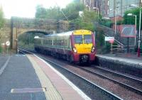 334009 at Johnstone station with a train bound for Largs<br><br>[Graham Morgan&nbsp;09/10/2006]