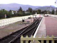The shunt head where SPR locos run around at Aviemore. Level access to the Strathspey Platform is via a boardwalk protected by the gate, or via the NR station footbridge, for the fitter. The Grampian Mountains in the distance.<br><br>[Brian Forbes&nbsp;19/09/2006]
