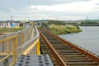 This bridge links the dock network to the Workington Steelworks network. The main Cumbrian Coast Railway is in the background right.<br><br>[Ewan Crawford&nbsp;27/09/2006]