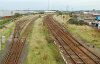 Looking north to Workington station over the now silent yard. The sidings to the left held the loaded trains of rails.<br><br>[Ewan Crawford&nbsp;27/09/2006]