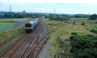 Looking south at Derwent Junction. Workington Docks line to right, Workington station in distance. A train consisting of a two carriage and single carriage Sprinter heads south.<br><br>[Ewan Crawford&nbsp;27/09/2006]