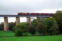 An EWS class 66 locomotive with a loaded coal train from Killoch washery ventures out onto Enterkine Viaduct in October 2006.<br><br>[Ewan Crawford&nbsp;06/10/2006]