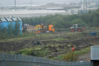 Equipment being unloaded at the former carriage sidings at Cowlairs. Note some site clearance has taken place.<br><br>[Ewan Crawford&nbsp;17/10/2006]