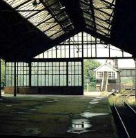 Looking out from the trainshed on the south side of the triangle at Bishop Auckland station towards the east box around 1977. [See image 19360]<br><br>[Ian Dinmore //1977]