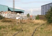 Leith South goods depot stands behind locked gates on the abandoned link from Leith South yard in September 2006. The VA Tech building on the right is located within the dock estate, with the cranes between the two standing alongside the Edinburgh Dock.<br><br>[John Furnevel&nbsp;12/09/2006]