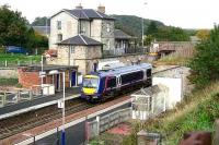 Despite having seen better days the old station at Markinch still retains much character. Scene shows the main station buildings with a train at platform 2 on 20 October 2006 with work getting underway off camera on the revised station layout and new interchange building.<br><br>[John Furnevel&nbsp;20/10/2006]