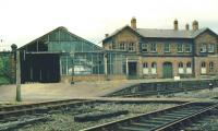View west towards the old Bishop Auckland station from alongside Bishop Auckland East box in the 1970s. The Crook platform is under the  trainshed on the left with the Durham platform turning off to the right.<br><br>[Ian Dinmore //]