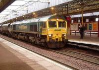 66511 passes through Paisley Gilmour Street with a loaded coal train<br><br>[Graham Morgan&nbsp;25/10/2006]