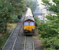 Loaded refuse containers destined for Oxwellmains head south out of Powderhall behind EWS 66233 on 27 October 2006.<br><br>[John Furnevel&nbsp;27/10/2006]