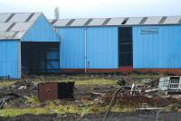 The shed at the Cowlairs Carriage Sidings viewed from the east with the remains of the train-washer in the foreground.<br><br>[Ewan Crawford&nbsp;28/10/2006]
