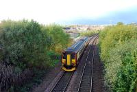 Westbound Sprinter at the site of Possilpark station. The replacement Possilpark and Parkhouse station is behind the camera.<br><br>[Ewan Crawford&nbsp;28/10/2006]