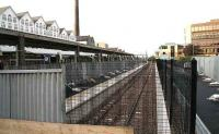 Platform 0 looking west over the barrier at the end of the bay on 29 October 2006. The car park is to the right of the black metal fence and platform 1 on the left behind the hoarding.<br><br>[John Furnevel&nbsp;29/10/2006]
