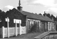 Carron station building with nameboard reversed on 18 April 1977.<br><br>[John McIntyre&nbsp;18/04/1977]