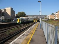 A northbound Southern unit heads towards Watford Junction, whilst a southbound Silverlink unit heads towards Clapham Junction.<br><br>[Michael Gibb&nbsp;04/11/2006]