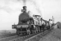 GNSR No 49 takes water at Barrhill with Scottish Rambler while HR 103 is oiled.<br><br>[John Robin&nbsp;15/04/1963]